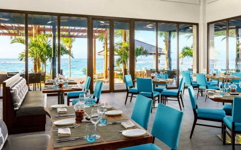 restaurant with blue chairs and view
