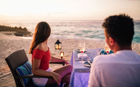 couple having romantic meal by the beach