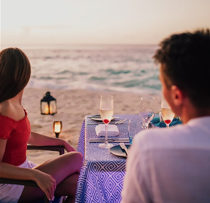 couple having romantic dinner by the beach