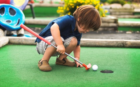 child playing put put - gallery image