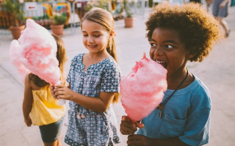 children eating cotton candy - gallery image
