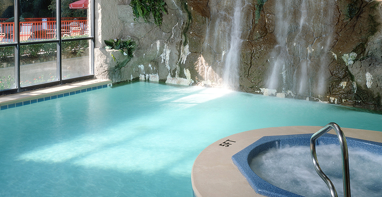 Indoor waterfall pool with hot tub