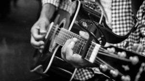 Black and White Photo Titled The Guitar Player by Walid Yassine