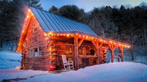 Wood Cabin with Christmas Lights in the snow