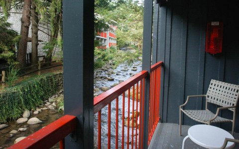 View of stream right beside on outdoor deck