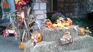 Harvest festival halloween pumpkin decorations on hay bales
