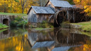 Picturesque wooden mill at the water's edge