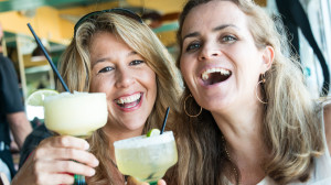 Two women drinking margaritas