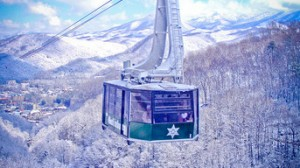 Ski lift in snowy mountains